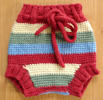 Joven makes wool soakers, shorts and pants that are fabulous cloth diaper covers.